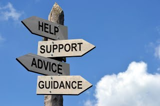 Pole with the signs: Help, Support, Advice, Guidance