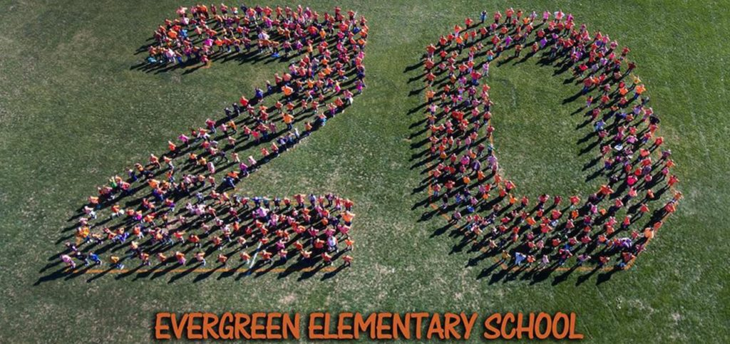 Aerial view of students in the shape of a 20